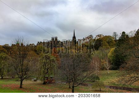 Beautiful cloudy and colorful autumn or early winter's view of Princes Street Garden and Old Town Edinburgh Scotland.