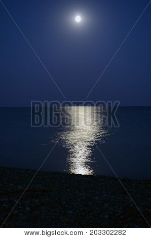 the moonlight reflected in waterwater smooth surface in a moonlight