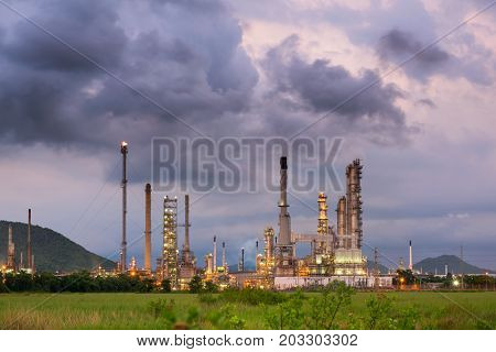 Oil and Gas refinery plant at twilight before storm. Business power and energy industrial
