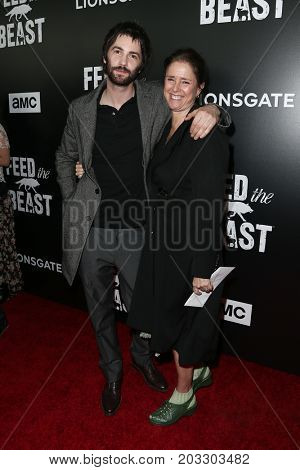 NEW YORK - MAY 23: Jim Sturgess (L) and Julie Taymor attend the AMC's 'Feed The Beast' premiere on May 23, 2016 in New York City.