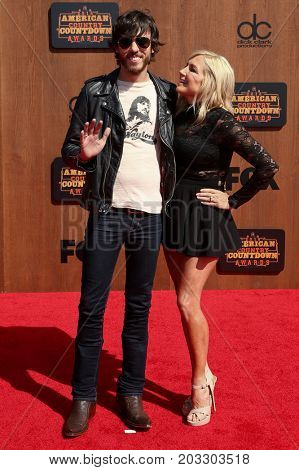INGLEWOOD, CA - MAY 01: Singer Chris Janson (L) and wife Kelly Lynn attend the 2016 American Country Countdown Awards at The Forum on May 01, 2016 in Inglewood, California.