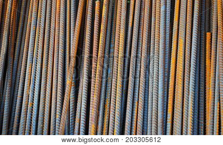 Reinforcing bar or rebar is a common steel bar that is hot rolled and is used widely in the construction industry especially for concrete. Steel Rebar Textured Background. poster