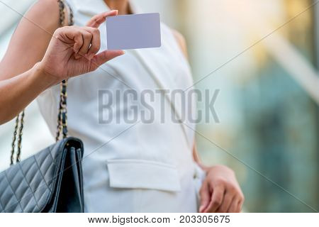 Businesswoman Showing White Empty Card