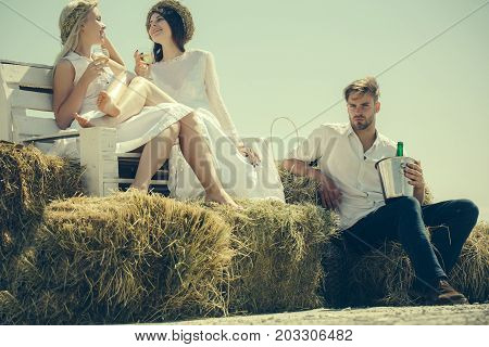 Happy Women Drinking Wine On Bench