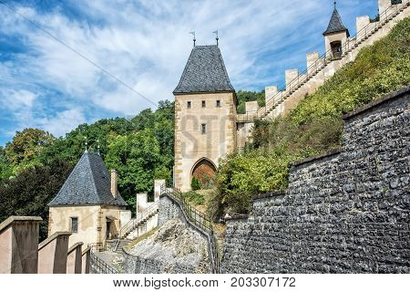Gothic castle Karlstejn in Czech republic. Ancient architecture. Travel destination. Walls and turrets.