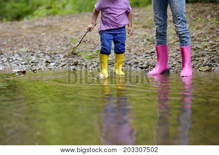 Two pairs of color children's gumboots standing children. Walk in color rubber children's boots