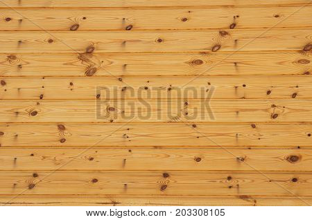 Raw wood wooden slatted fence or wall