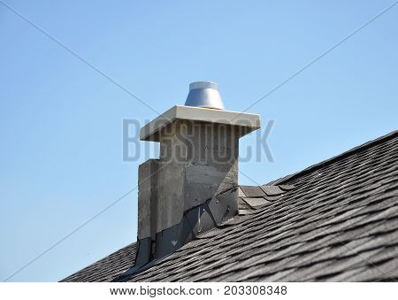 New modular ceramic chimney on the house roof. Thermocrete Chimney Linings.