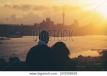 Happy Senior Couple Watching Sunset In Auckland