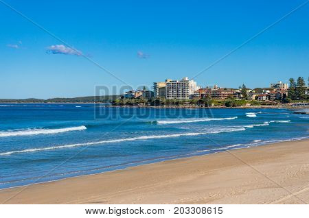 Ocean Shoreline With Sandy Beach And Waterfront Houses