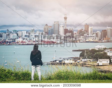 Young Woman Looking Auckland City Skyline