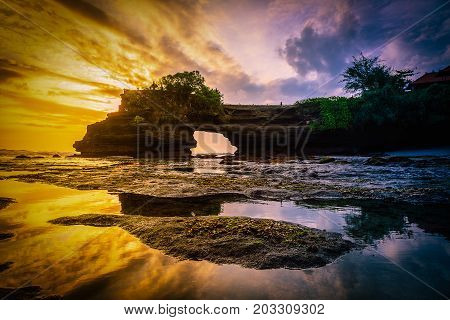 Tanah Lot Temple on sea at sunset in Bali Island Indonesia.