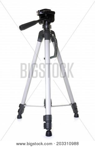 metal tripod in front of white background