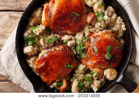 One Pot: Fried Chicken Thighs With Quinoa And Mushrooms Close-up. Horizontal Top View
