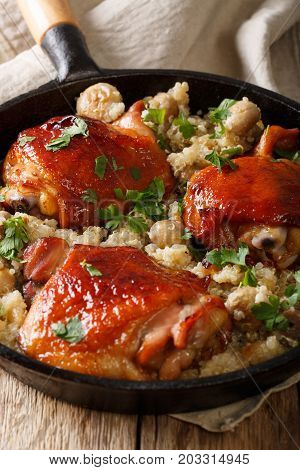 One Pot: Fried Chicken Thighs With Quinoa And Mushrooms Close-up. Vertical