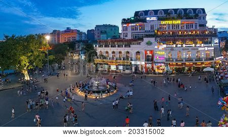 Hanoi City Square With Fountain With People In The Evening