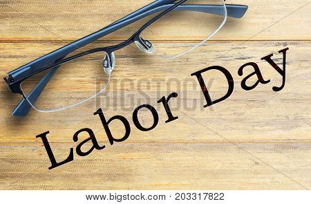 Labor Day is a federal holiday of United States America. Top view with glasses on old wooden table background. Space for use and any design.