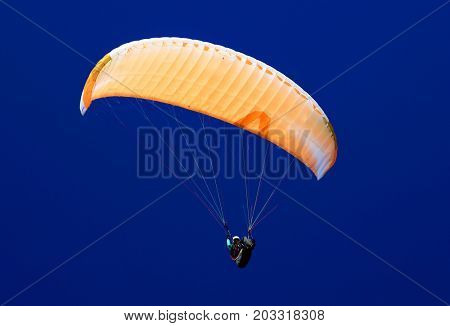 Paraglider against the blue sky
