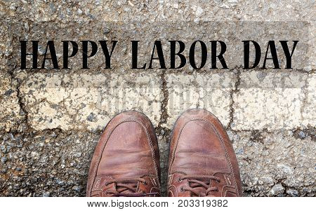 Labor Day is a federal holiday of United States America.Top view with Brown leather shoes on the cement road background. space for use and any design. Business and labor day concept.