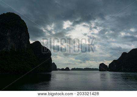 Dark silhouettes of karst islands of Halong Bay on dusk. HaLong Bay Vietnam