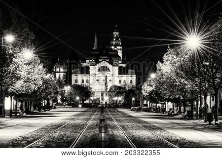 Main square with plague column national theatre and St. Elisabeth cathedral in Kosice Slovak republic. Night scene. Travel destination. Black and white photo.