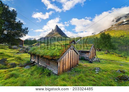 Innerdalen - mountain valley of Norway. Traditional Norwegian houses with a turf roof. Old farm hotel near Lake Innerdalsvatna