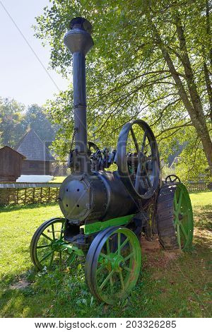 Old fashionned thresher in small village, close up