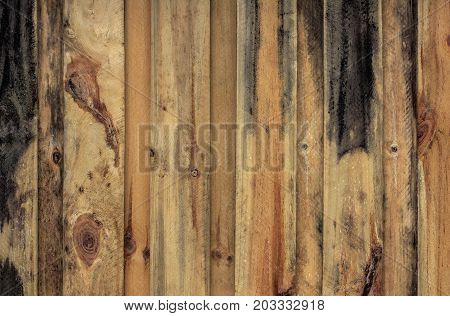 a close up picture of a new wooden fence