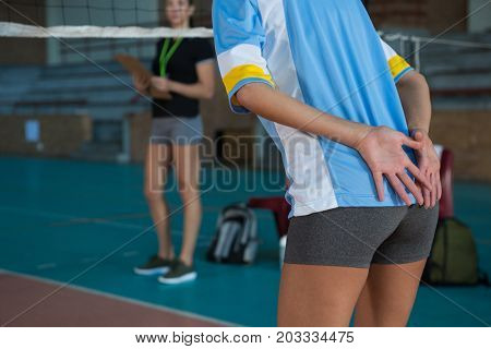 Mid section of female volleyball player gesturing while playing