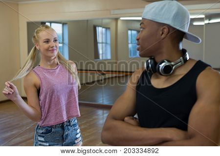 Young male dancer looking at friend in dance studio