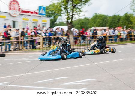 Car And Kart Driver In Fast Moving During The Open Competitions