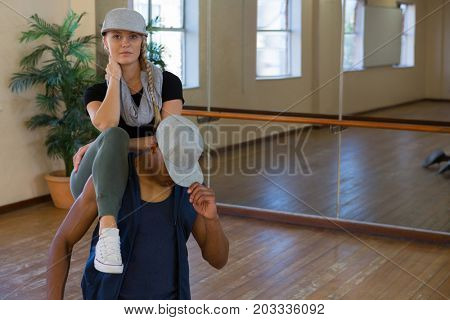 Portrait of young dancer with male friend in dance studio