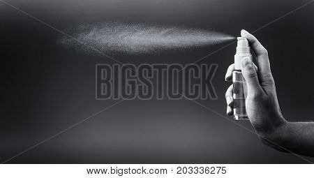 Mini Bottle Sprayer On Gray Background.