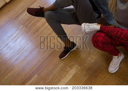 Low section of dancers rehearsing on floor in studio