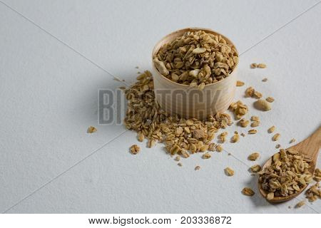 Close-up of oat flakes in a wooden bowl and spoon