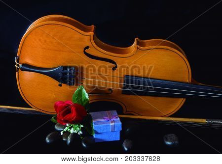 Valentine with music. Celebration of the day of lovers with music and a gift.