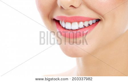 Closeup shot of woman's smile with white healthy teeth, isolated on white background