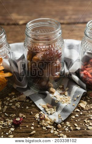 Close-up of jar with dates on wooden table