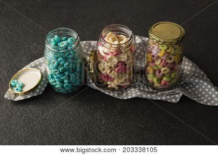 Three jars with various breakfast on black background