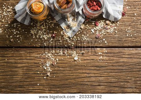 Three jars with various breakfast on wooden table
