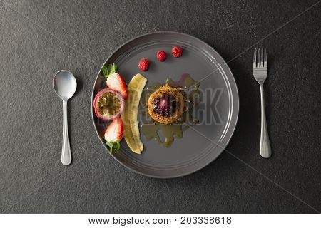 Close-up of healthy breakfast with fruits in a plate