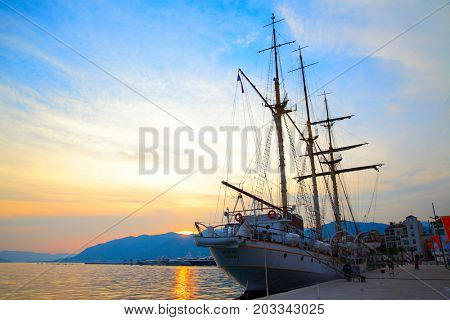 Tivat, Montenegro - June 16, 2017: Silhouette of sailing ship near sea-front in Tivat