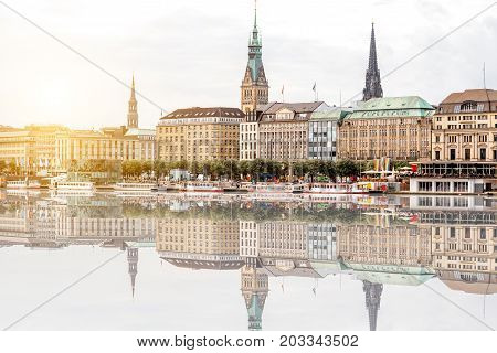 Riverside view with city hall and church tower in the old town centre of Hamburg, Germany