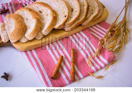 Sliced crusty country style round organic french bread on the table.