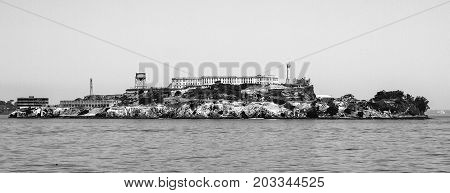 Panorama of Alcatraz Island with famous prison building, San Francisco, USA. Black and white image.