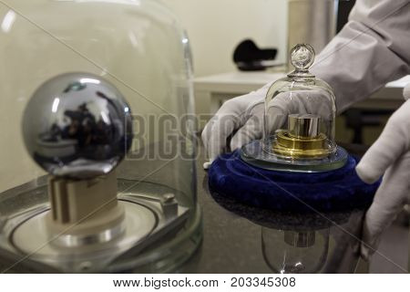 ST. PETERSBURG, RUSSIA - APRIL 25, 2017: Keeper of standard of mass Victor Snegov with National standards of the unit of mass in D.I. Mendeleyev Institute for Metrology. Institute was founded in 1842