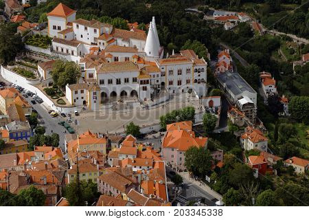 SINTRA, PORTUGAL - MAY 10, 2017: Aerial view to the National Palace of Sintra, the best-preserved medieval royal residence in Portugal. Since 1995, Sintra is listed as UNESCO World Heritage