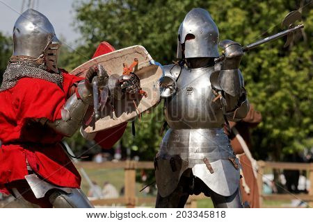 ST. PETERSBURG, RUSSIA - JULY 9, 2017: Armored knight fighting in the tournament during the military history project Battle On Neva. It's the 4th such an event