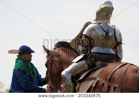ST. PETERSBURG, RUSSIA - JULY 8, 2017: Armored knight on a horse participating in the jousting tournament during the military history project Battle On Neva. It's the 4th such event