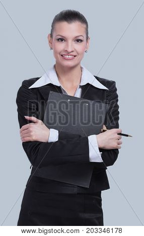 Beautiful young business woman isolated on gray background.